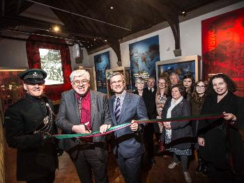 Col. James Ramsbotham, Cllr Neil Foster and Dr Keith Bartlett are joined by a few of the staff and volunteers to open the new exhibition.
