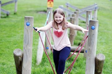Girl on rope bridge