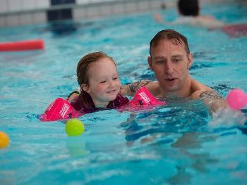 Father and child swimming