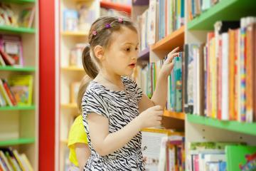 Library child selecting book