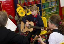 School girl playing guitar