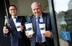 Cllr Brian Stephens and Northumbrian Water's finance director Chris Johns fill up reusable bottles and cups January 2019