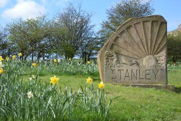 Stanley sculpture and flowers