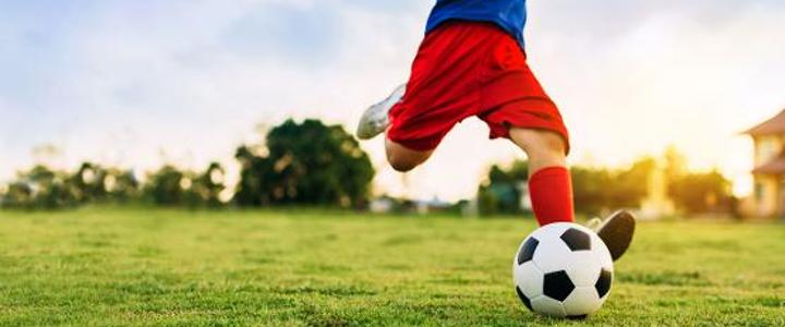 Action sport - kid playing soccer
