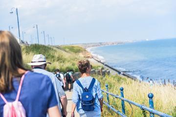 People walking next to coast